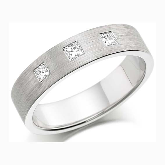 217 - Set with three princess cut diamonds and brushed finish.