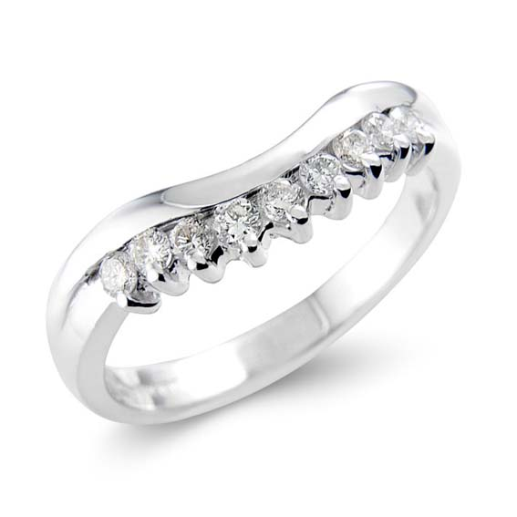 609 - Slight curve with nine claw set diamonds.