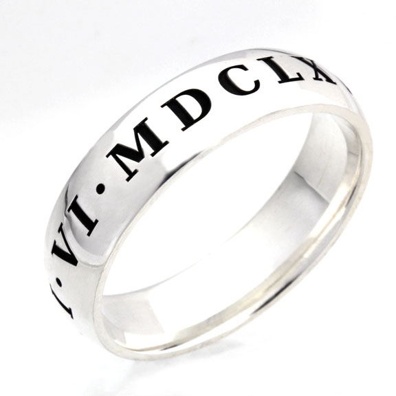 Roman numerals engraved on the outside of your wedding ring.