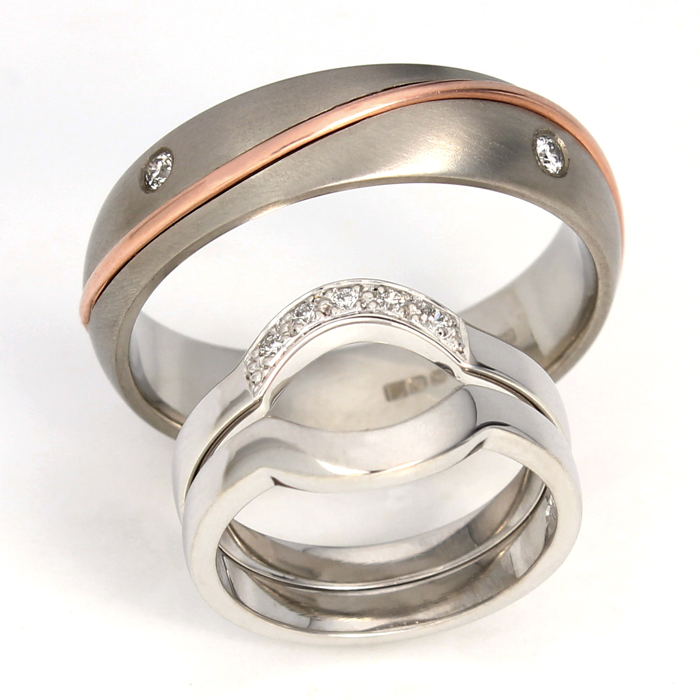 Shaped wedding and eternity ring and rose gold inlay