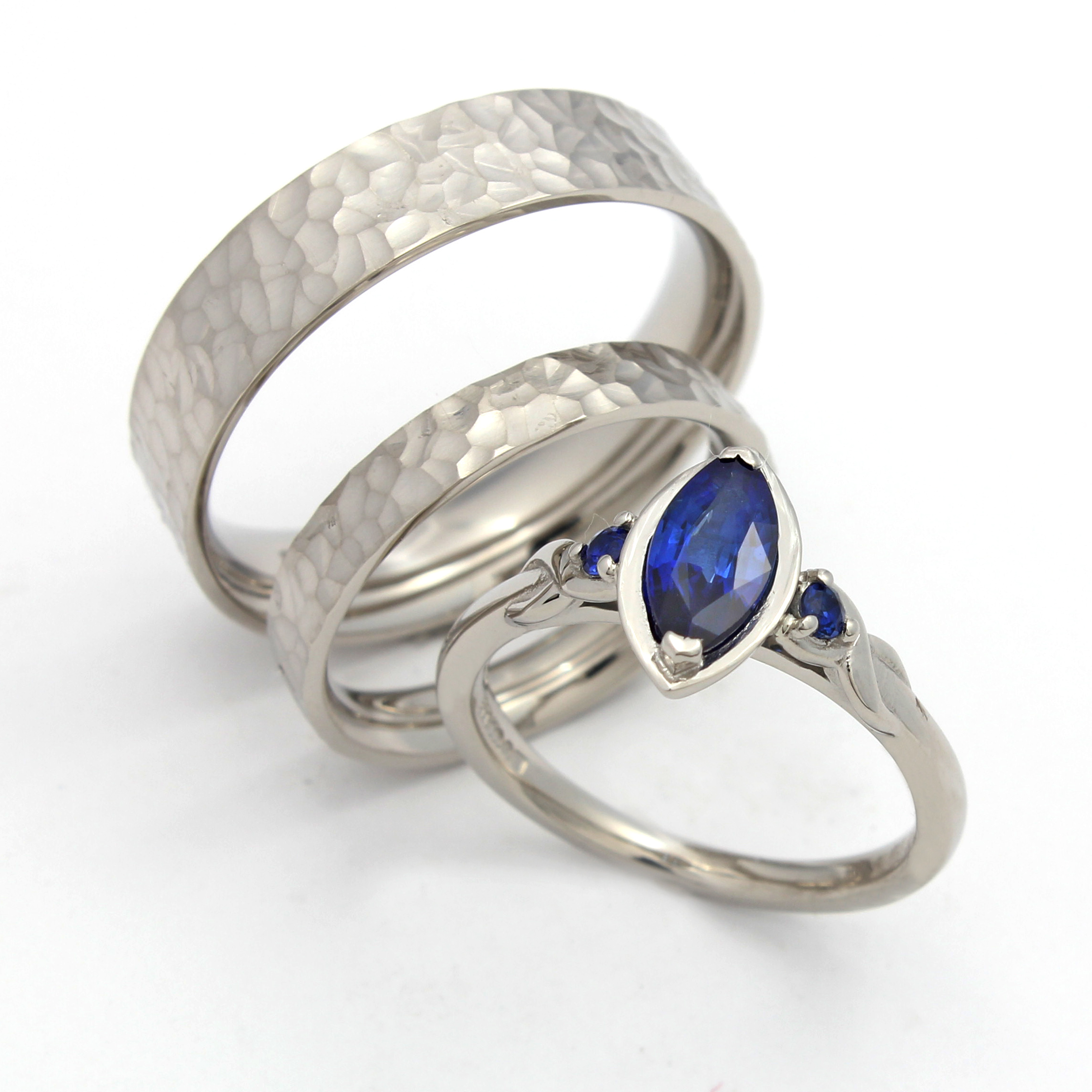 Sapphire engagement ring and matchine hammered wedding rings